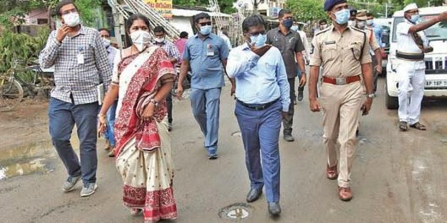 Collector I Samuel Anand Kumar, SP RN Ammi Reddy and GMC Commissioner  C Anuradha inspect containment zones in Guntur city on Friday
