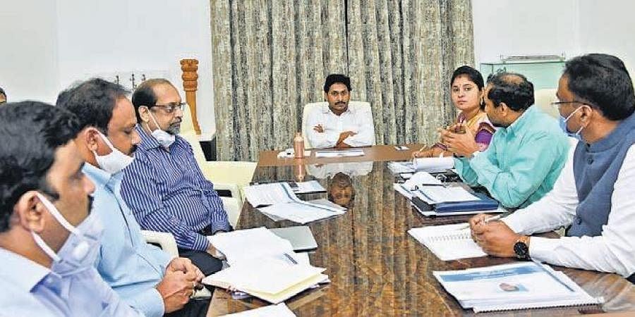 Chief Minister YS Jagan Mohan Reddy holds a review meeting on ROFR at his camp office in Tadepalli on Friday