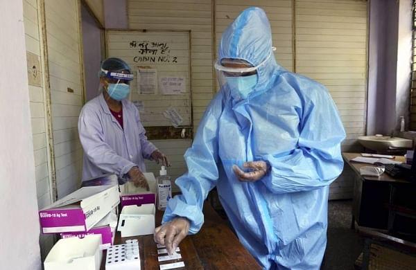 A medic sorts samples for COVID-19 rapid antigen testing during Unlock 2.0 in New Delhi Saturday July 11 2020. (Photo | PTI)