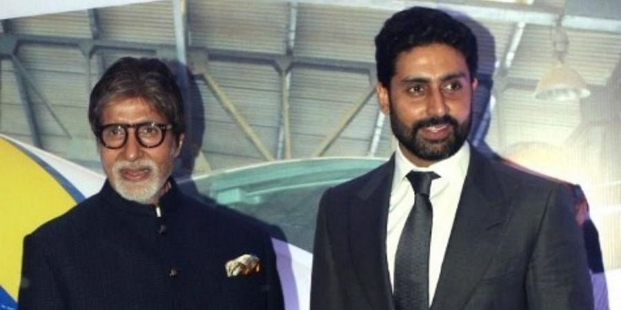 Bollywood father-son duo Amitabh (L) and Abhishek Bachchan