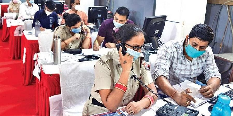 Counsellors working at a surveillance and telemedicine hub to monitor status of Covid patients under home isolation in New Delhi on Saturday