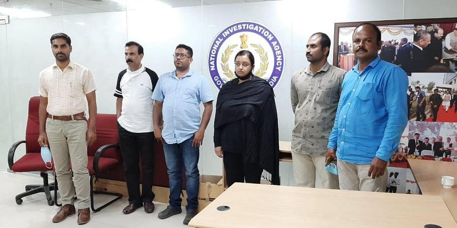 Accused Swapna Suresh and Sandeep Nair (both in middle) detained by National Investigation Agency from Bengaluru, Karnataka on Saturday.