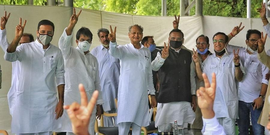 In a display of strength, CM Ashok Gehlot poses with MLAs at the meeting at his residence.