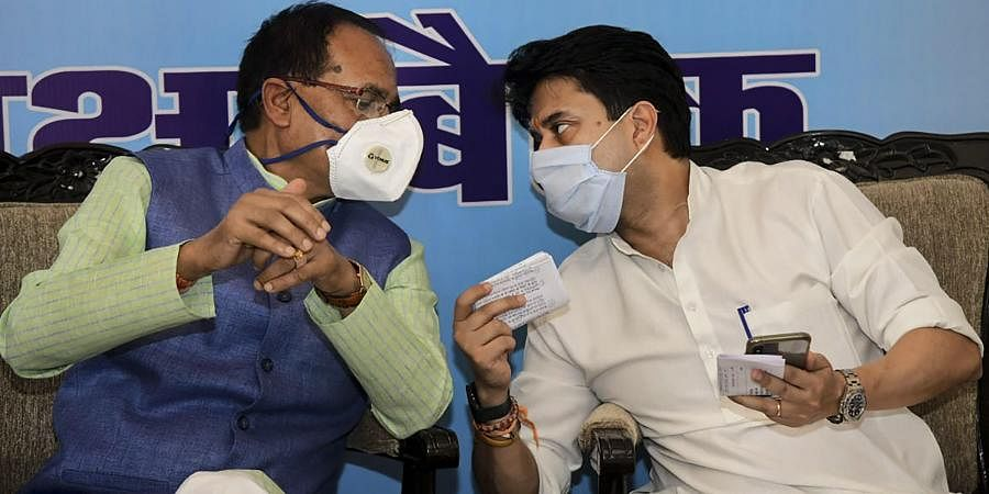 Madhya Pradesh Chief Minister Shivraj Singh Chouhan and BJP leader Jyotiraditya Scindia during a meeting to review crisis management committee at Hatpipaliya in Dewas district Tuesday July 14 2020.