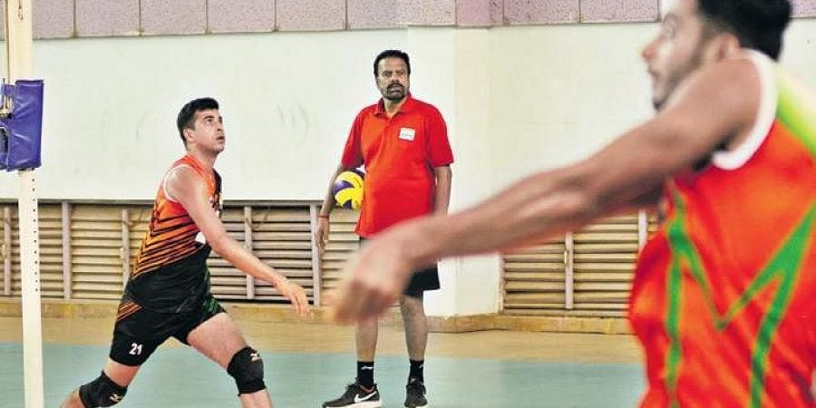Indian volleyball team during a practice session at Sports Authority of India complex in Bengaluru