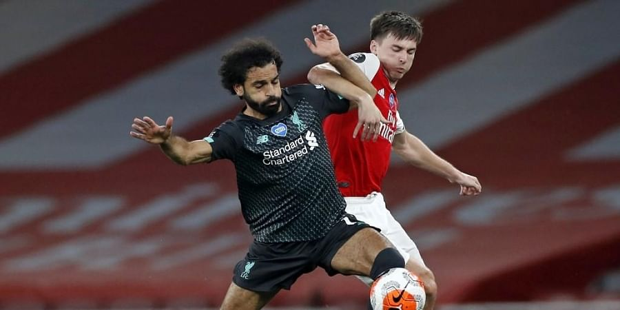 Liverpool's Egyptian midfielder Mohamed Salah (L) vies with Arsenal's Scottish defender Kieran Tierney (R) during the English Premier League football match between Arsenal and Liverpool. (Photo | AFP)