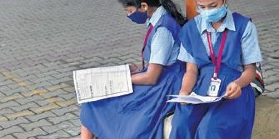 Two girls revise outside an SSLC examination centre.