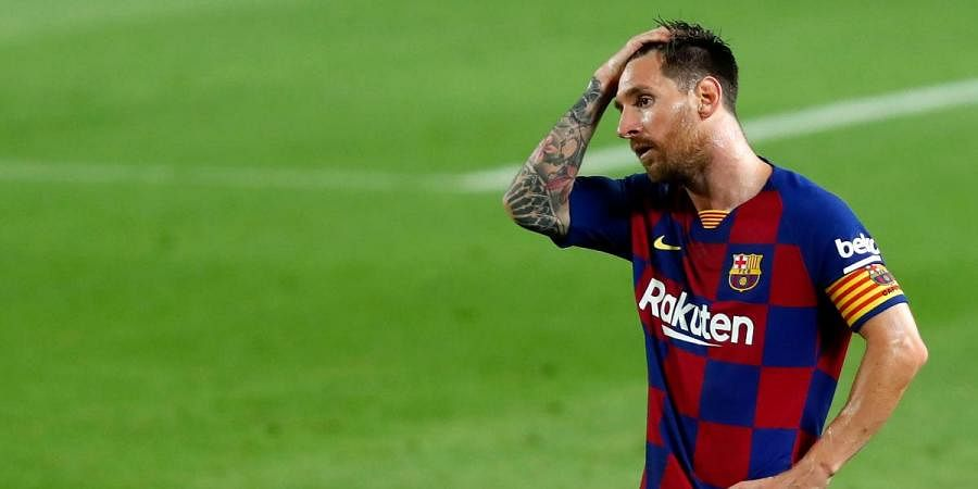 Barcelona's Lionel Messi reacts after the end of a Spanish La Liga soccer match with Osasuna at the Camp Nou stadium
