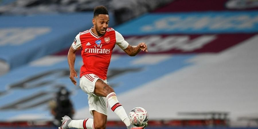 Arsenal's Gabonese striker Pierre-Emerick Aubameyang controls the ball during the English FA Cup semi-final football match between Arsenal and Manchester City. (Photo | AFP)