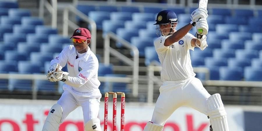 Rahul Dravid hits a four in front of West Indies wicketkeeper Carlton Baugh. (Photo | AFP)