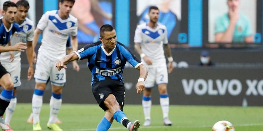 Inter Milan's Alexis Sanchez scores on a penalty kick his side's second goal during the Serie A soccer match with Brescia at the San Siro Stadium, in Milan