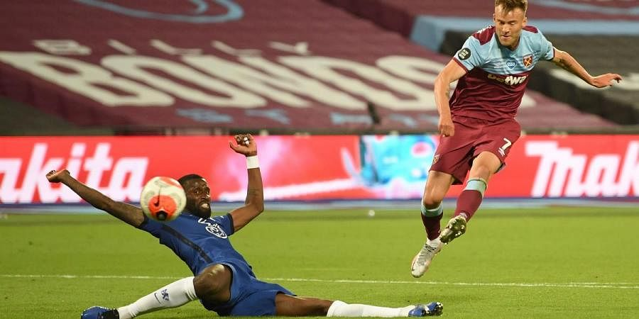 West Ham's Andriy Yarmolenko (R) shoots and scores the team's third goal past Chelsea's Antonio Rudiger during an English Premier League soccer match in London