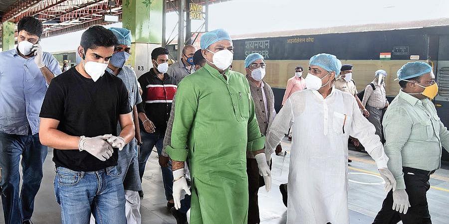 Gautam Gambhir and city BJP chief Adesh Kumar Gupta visit Anand Vihar railway station to check isolation coaches.