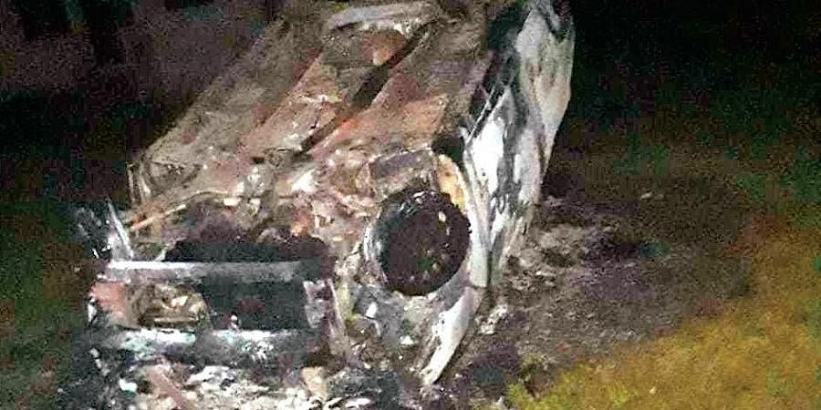The charred vehicle of the OIC of Krishnanandpur police outpost