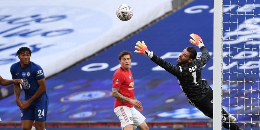 Manchester United's Spanish goalkeeper David de Gea (R) saves an attempt from Chelsea's English defender Reece James (L) during the English FA Cup semi-final football match. (Photo   AFP)