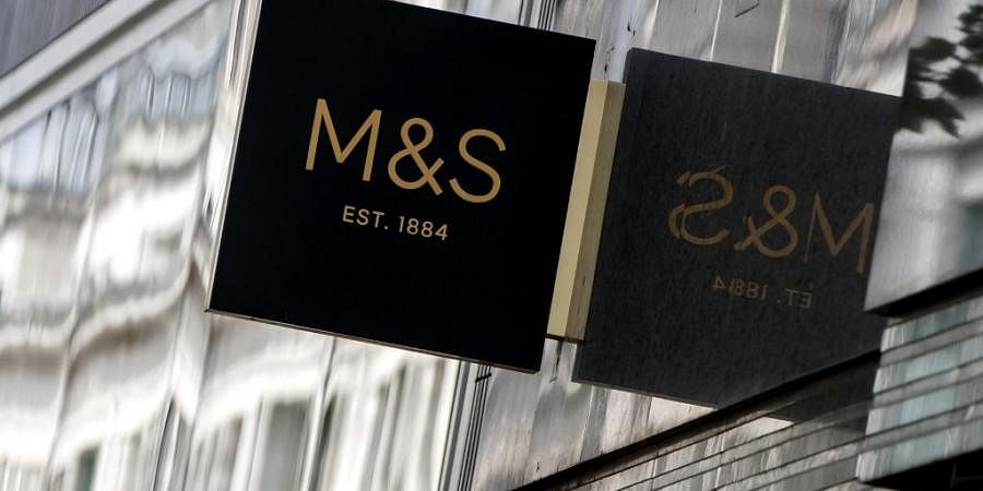 Marks & Spencer signage is seen on a shop in Oxford Street. (Photo| AFP)