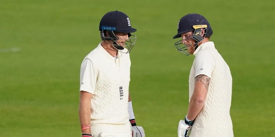 England's Joe Root (L) chats with England's Ben Stokes (R) on the fourth day of the second Test cricket match. (Photo | AFP)