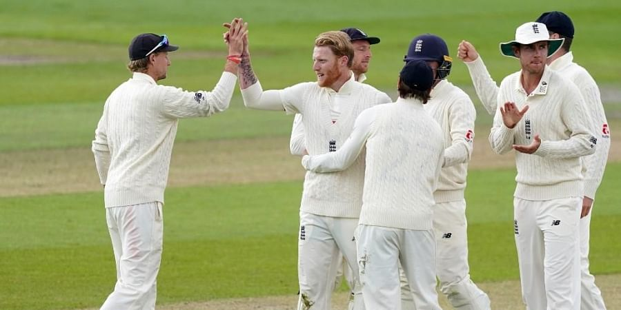 England's Ben Stokes (2nd L) celebrates with teammates after taking the wicket of West Indies' Jermaine Blackwood for 55 during play on the final day of the second Test cricket match between England and the West Indies. (Photo   AFP)