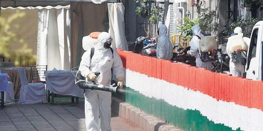 A man disinfecting the Nizamuddin Markaz after the Tablighi Jamaat congregation.