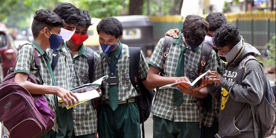 Students are going through textbooks  in Bengaluru.