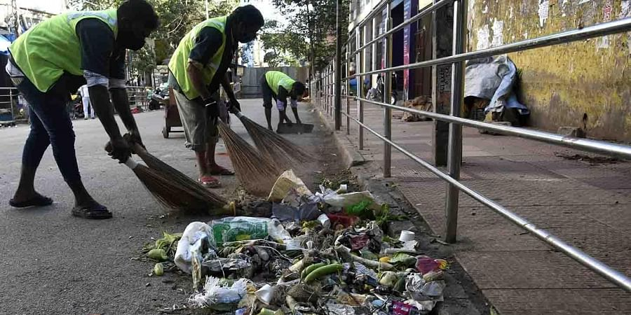 BBMP workers cleaning the Avenue Road  in Bengaluru