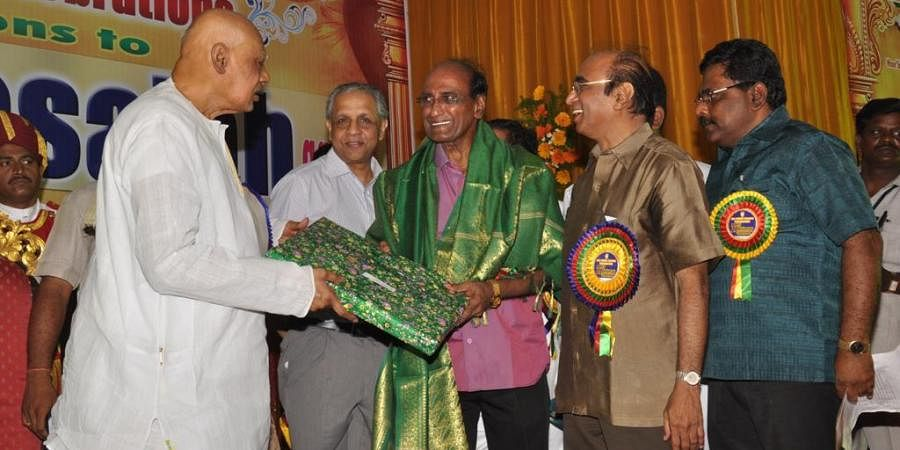 Dr C Mohan Reddy seen being felicitated by then Governor K Rosiah in this file photo.