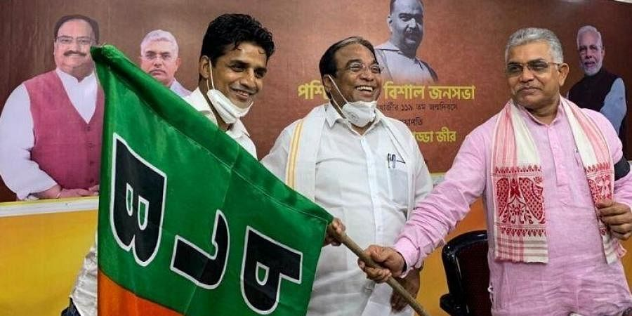 Mehtab Hossain (left) was welcomed into the BJP by the party's West Bengal chief Dilip Ghosh (right). (