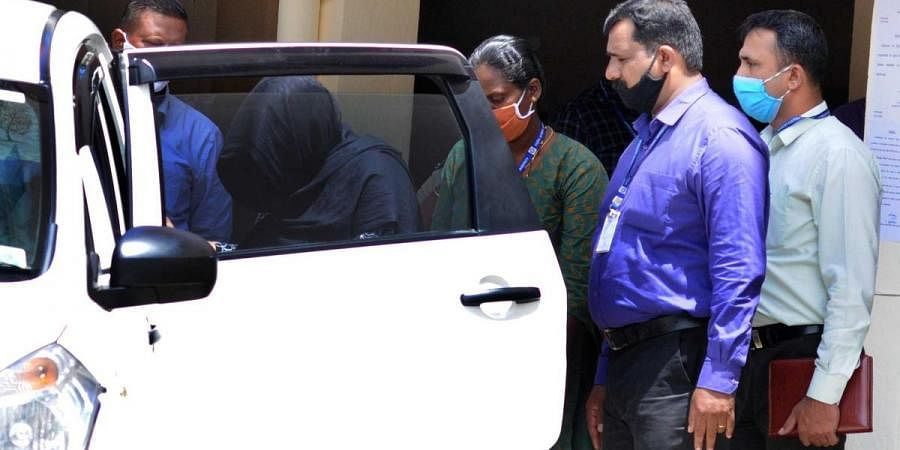 Kerala gold smuggling case accused Swapana Suresh being produced at NIA court in Kochi on Tuesday
