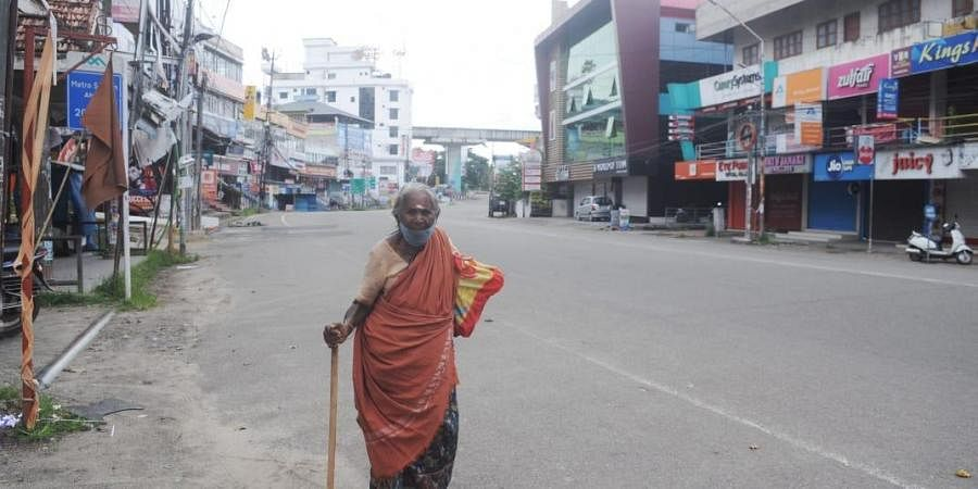 An elderly woman walks amid coronavirus curfew. (Photo| A Sanesh)