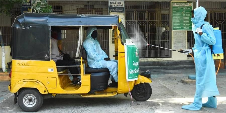 Disinfectants been sprayed on the Auto who take people to the covid care center at Adyar corporation school
