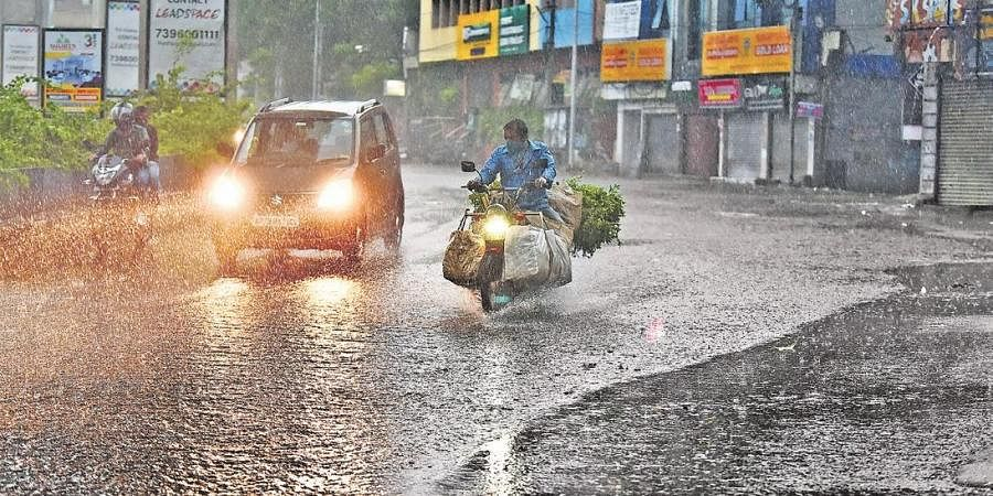 Vehicles move through inundated roads in Hyderabad on Thursday morning (Photo | RVK Rao, EPS)