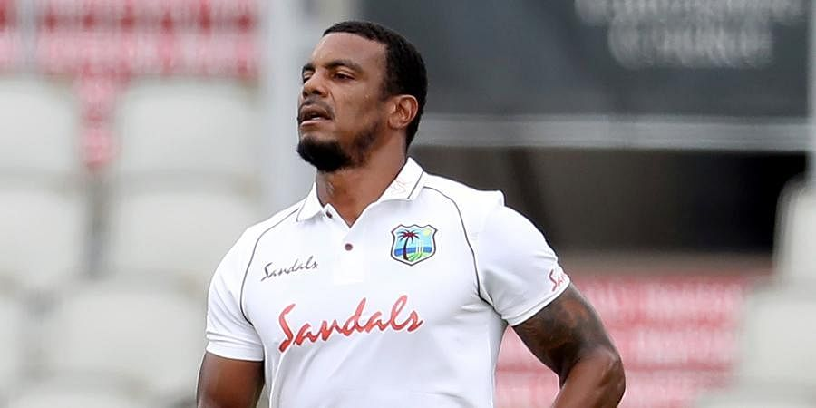 West Indies' Shannon Gabriel bowls during the first day of the third cricket Test match between England and West Indies at Old Trafford in Manchester.