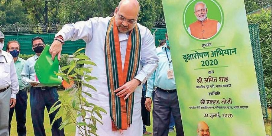 Home Minister Amit Shah waters a 'Rudraksha' sapling during the inauguration of Plantation Campaign 2020 and foundation laying ceremony of 6 Eco Parks, organised by Ministry of Coal in New Delhi