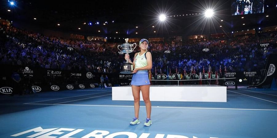 Sofia Kenin of the U.S. holds the Daphne Akhurst Memorial Cup after defeating Spain's Garbine Muguruza in the women's singles final at the Australian Open tennis championship. (Photo | AP)
