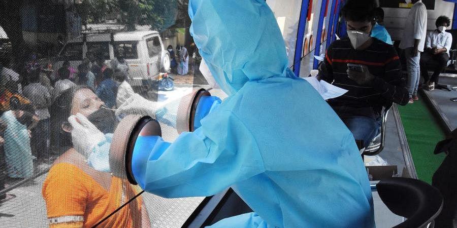 A medical staff takes swab samples COVID-19 test (Photo| EPS/ Madhav K)