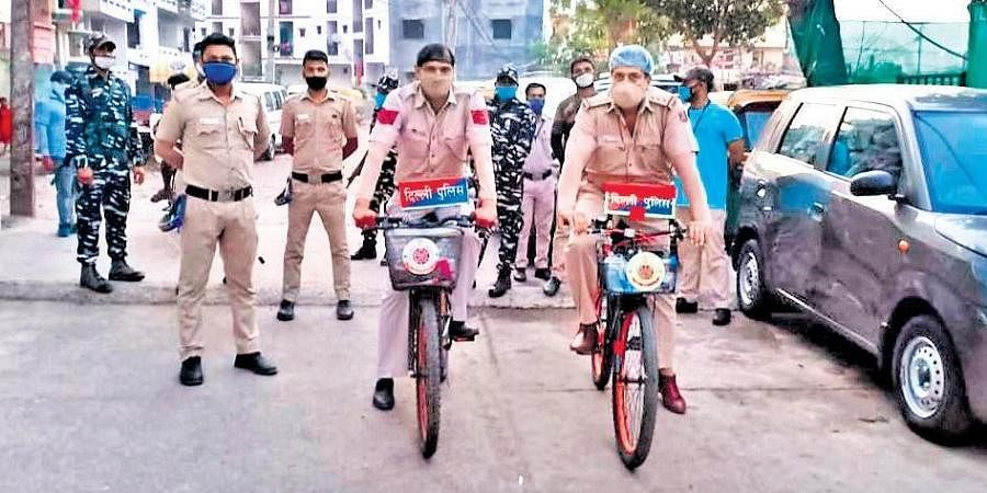 Delhi Police inspector Bala Shankar Upadhyay and his team bicycled through the narrow lanes of containment zones in Delhi to calm people's fears