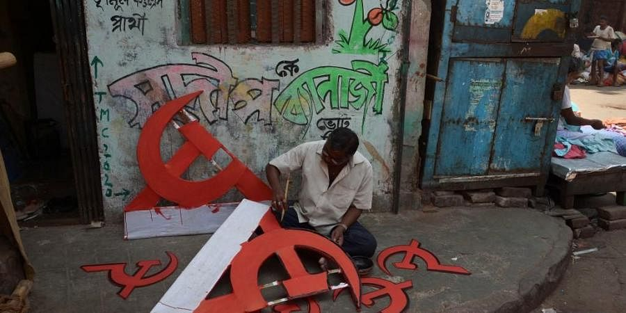 File: A man paints the CPM symbol to used for a rally. (Photo  AFP)