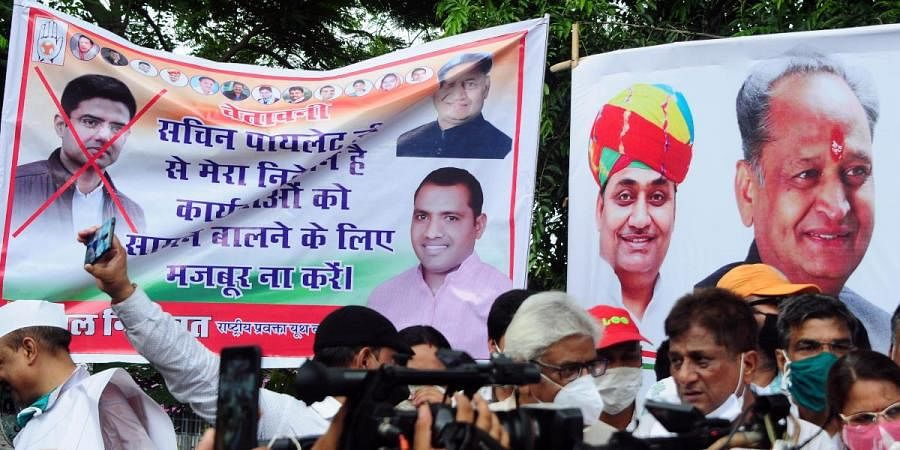 Cross mark is seen on the picture of Sachin Pilot in a poster during a protest by Congress party against BJP in Jaipur