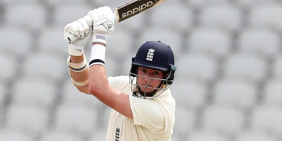 England's Stuart Broad plays a shot during the 3rd cricket Test match against West Indies at Old Trafford in Manchester