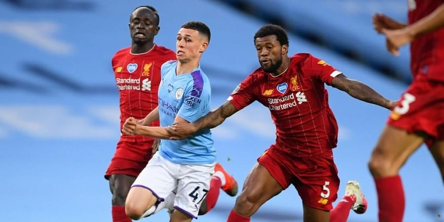 Manchester City's English midfielder Phil Foden (2nd L) vies with Liverpool's Senegalese striker Sadio Mane (L) and Liverpool's Dutch midfielder Georginio Wijnaldum (R )during the English Premier League football match between Manchester City and Liverpool