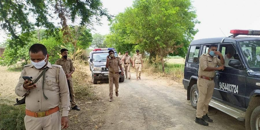 Police team investigates the site of encounter, where 8 police personnel lost their lives after being fired upon by criminals, in Kanpur, Friday, July 3, 2020.