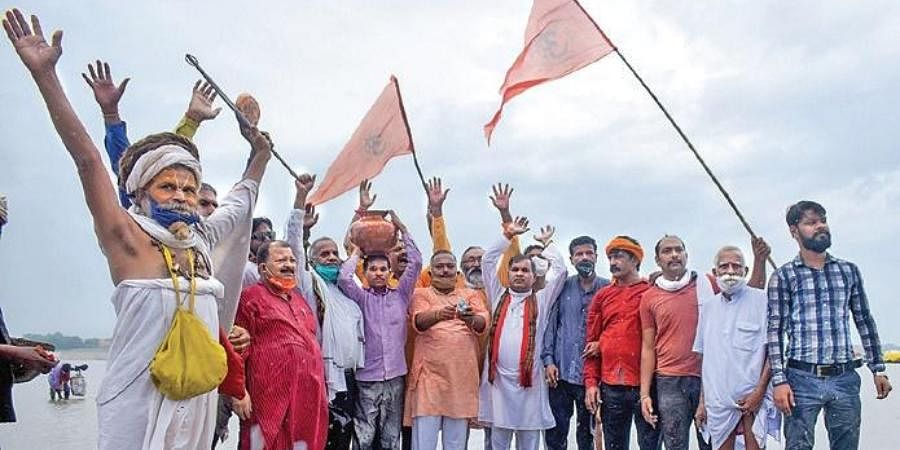 VHP members collect Ganga water and clay for the temple ceremony.