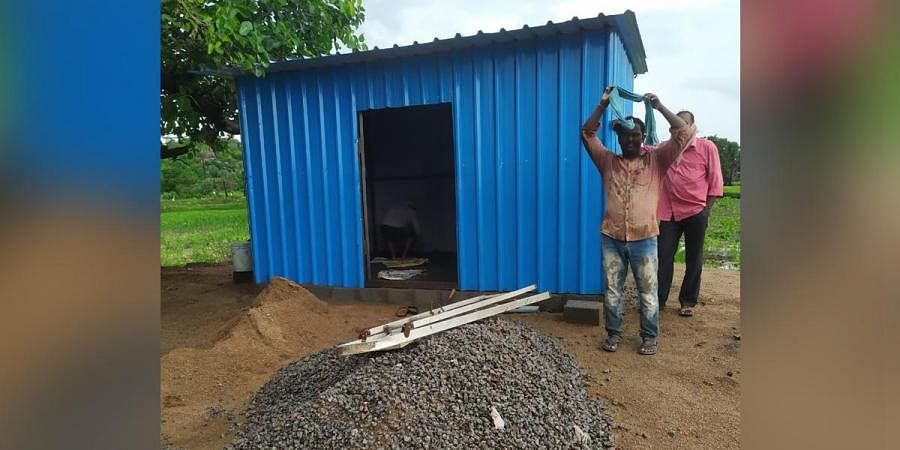 Former students of Rudrangi ZP High School construct a shed to set up a tiffin centre for their teacher