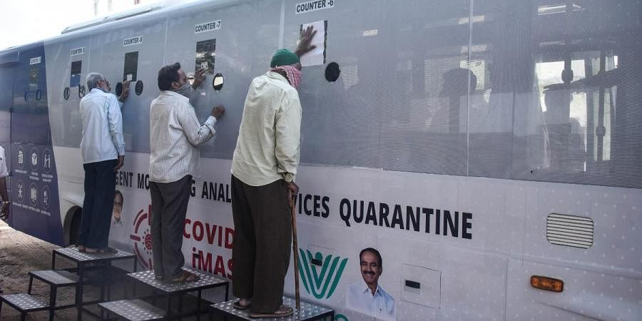 A mobile COVID-19 testing vehicle 'I-Mask' administering tests for suspected infectees in Hyderabad on Thursday