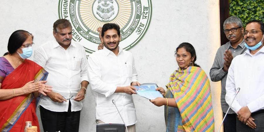 Andhra Pradesh CM YS Jagan Mohan Reddy handing over the appointment letters to the outsourcing employees after launching the APCOS in Tadepalli on Friday