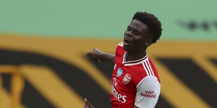 Arsenal's English striker Bukayo Saka celebrates scoring the opening goal. (Photo | AFP)