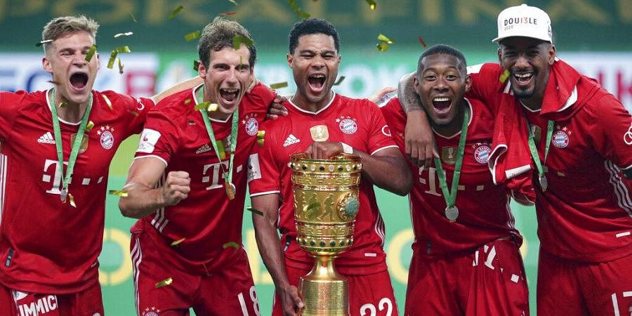 Bayern Munich players celebrate with the trophy after winning the German soccer cup (DFB Pokal) final match between Bayer 04 Leverkusen and FC Bayern Munich in Berlin, Germany. (Photo | AP)