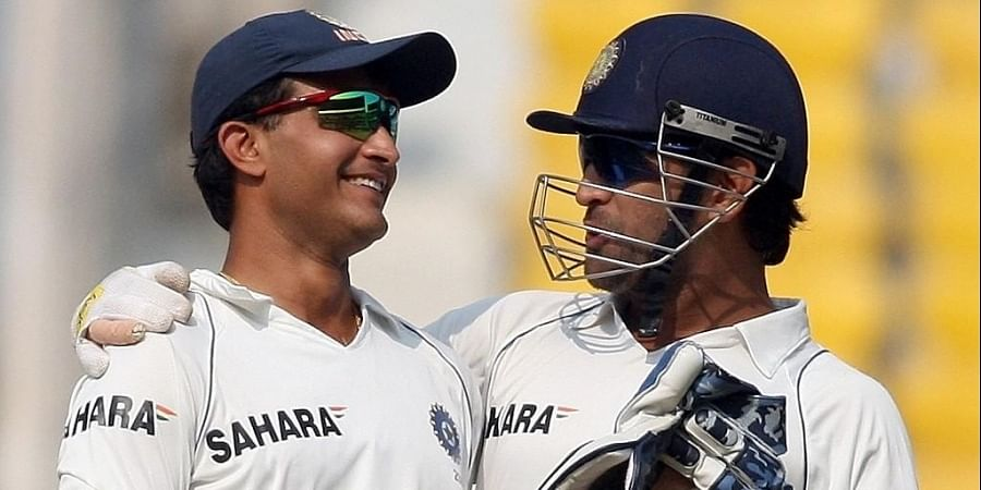 Indian cricketer Mahendra Singh Dhoni (R) speaks to Sourav Ganguly. (Photo   AFP)