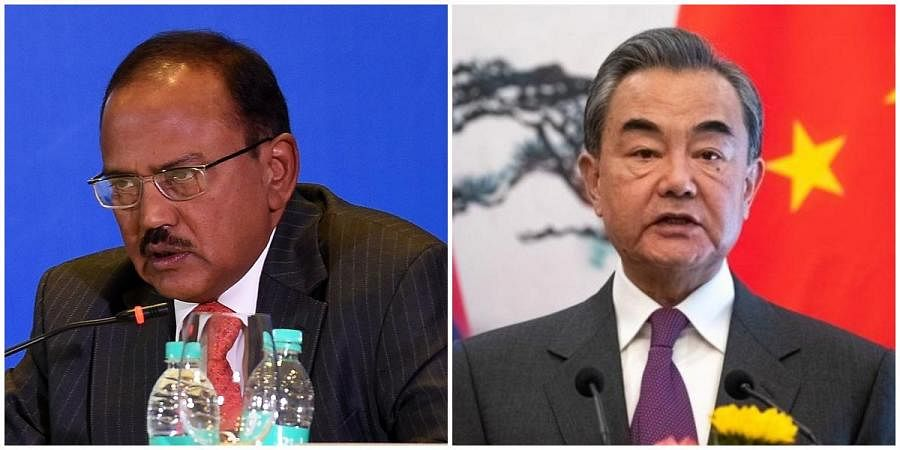 National Security Advisor Ajit Doval (L) and Chinese Foreign Minister Wang Yi