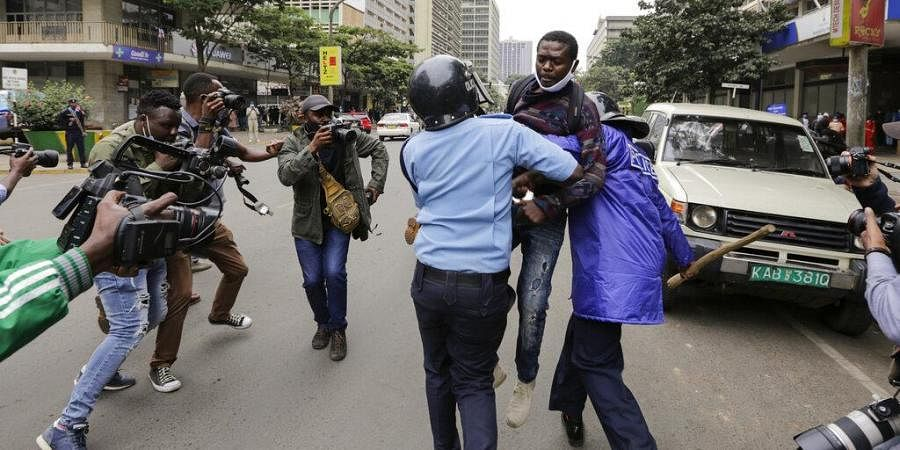 Kenyan police detain a protester at a demonstration against police brutality in downtown Nairobi. (Photo  AP)